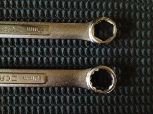 A wrench with a 6-point box-end sits next to a 12-point box-end for comparison.